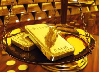 Gold schießt über 1.300 USD  angetrieben durch eskalierende Gewalt im Irak und der FOMC Beibehaltung niedriger Zinsen